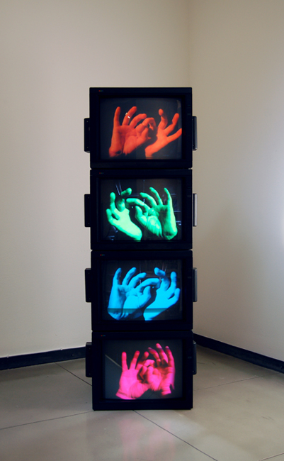 Untitled (Shepard-Risset Glissando with Color on Hopf Linked Hands), 2015.  Four monitors and media players.