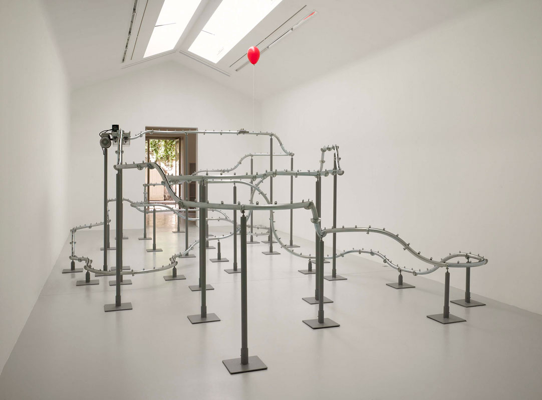Untitled, 2007. Conveyor track, motor, release mechanism, balloon. 96 x 216 x 420 inches